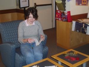 Kelci perusing a flip book