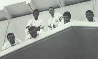 Priscilla Scotlan '68 (top row) was the first female Yell Leader at USF.  Pictured here are other Yell Leaders Pat Marantette, Tim King, Ed Chiosso, Frank Clifford, and Al Rodrigues. From the Don, 1968. From Gleeson Library's Digital Collections.