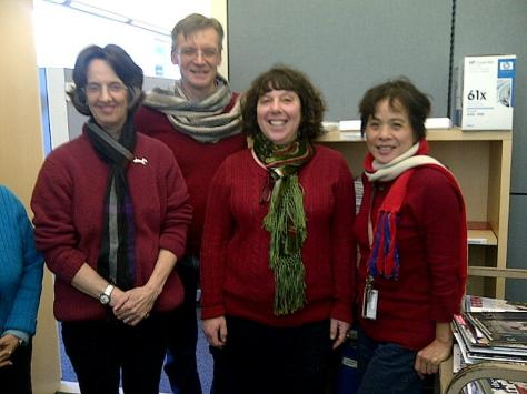 A serendipitous day of red sweaters: Helen (right) with her friends and colleagues Kathy (left), David (center left), and Debbie (center right).