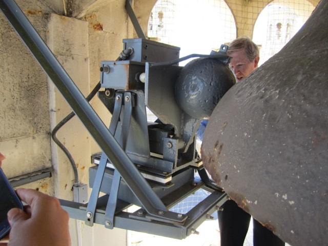 The single bell in the Northeaster tower is also rung by electric mechanism--this large clapper strikes the exterior of the bell, producing visceral vibrations.