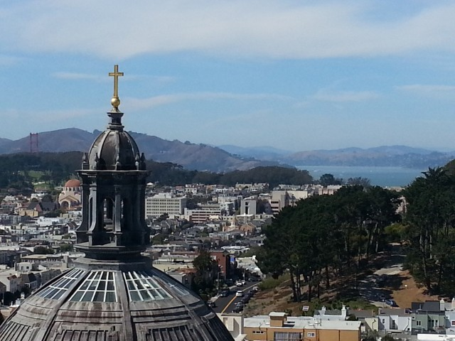 The main dome of Saint Ignatius with views of the city and Golden Gate Bridge as backdrop. Jaw Dropping!!