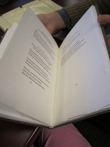 Double spread of a poem featured in Looking for Peace. Notice the deckled edges of the paper.