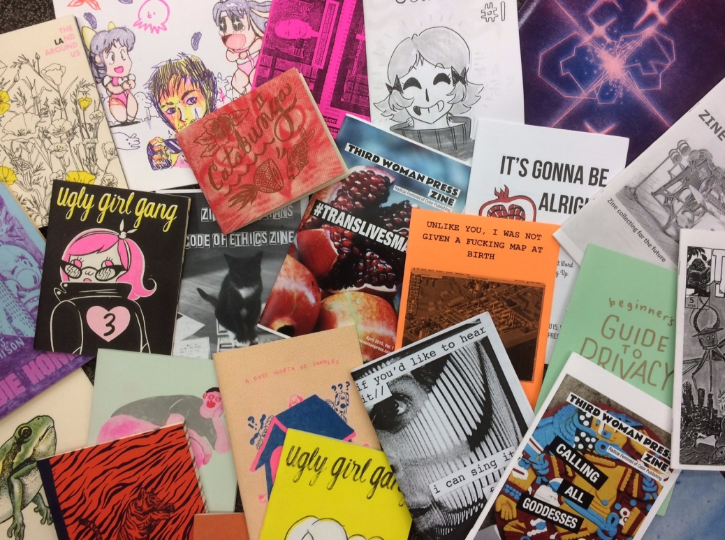A collection of zines piled together