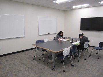 Gleeson 2nd Floor: students using one of the new, bookable study rooms