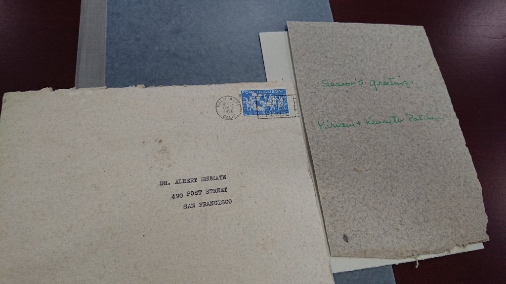 Envelope addressed to Dr. Albert Shumate with card saying Season's Greetings and signed by Miriam and Kenneth Patchen