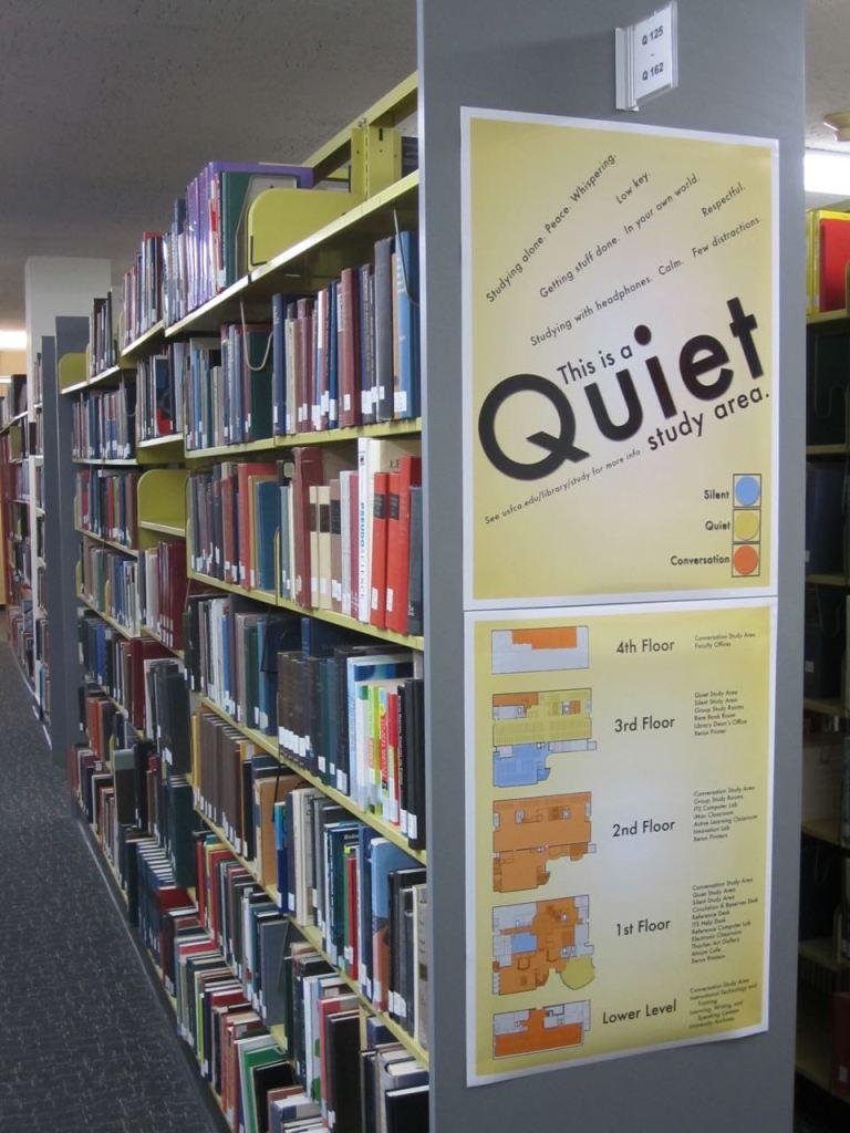 Quiet sign on bookshelf