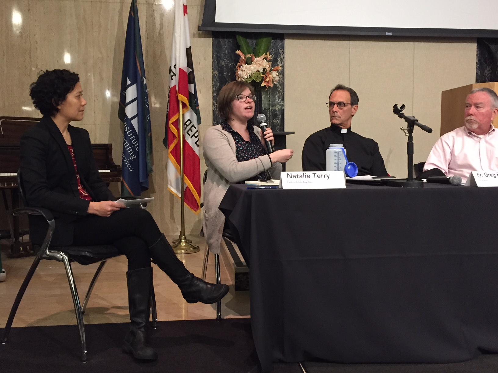 Professor Evelyn Ho moderating discussion about immigration and sanctuary