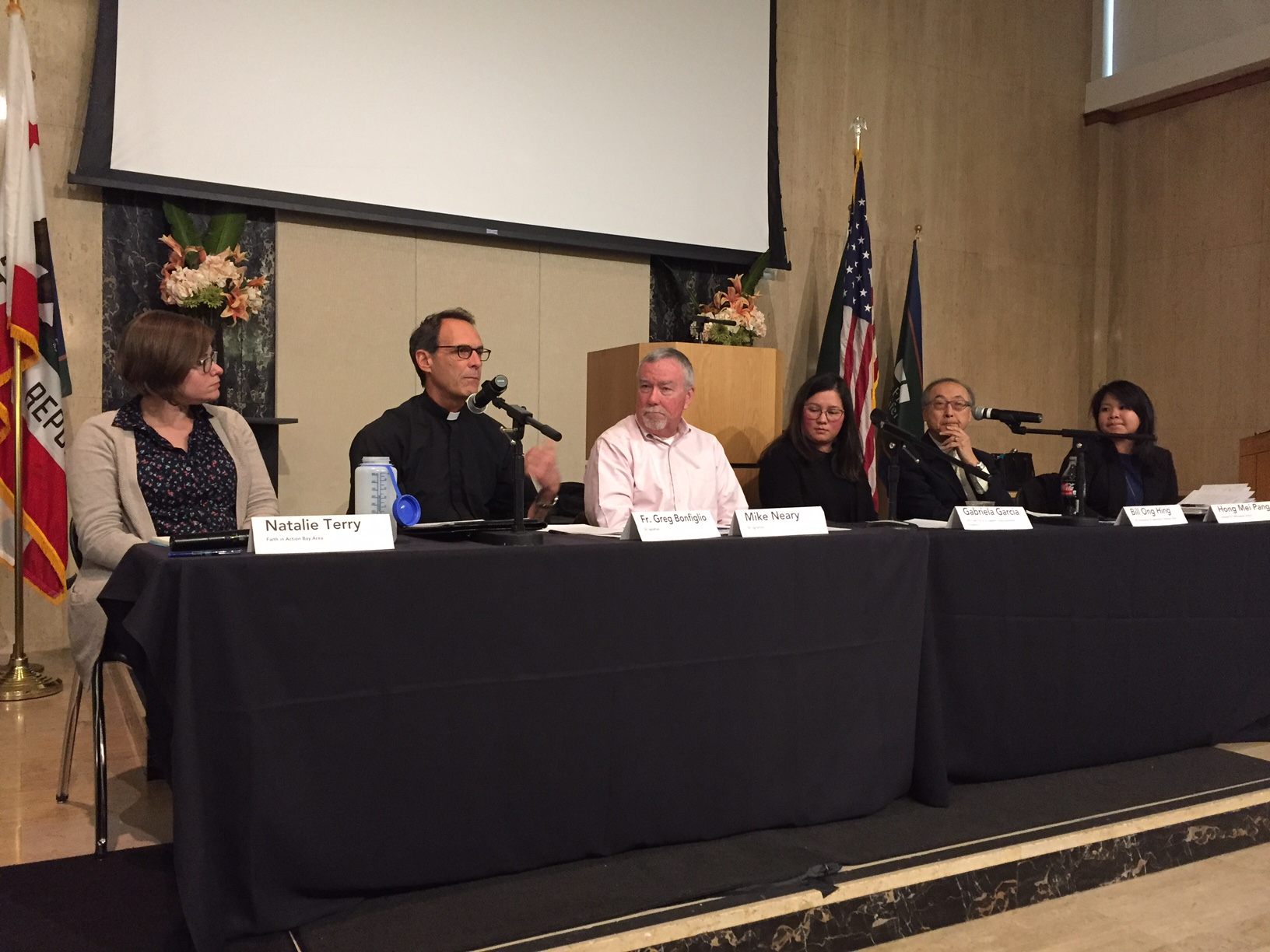 Panelists speaking on immigration and sanctuary