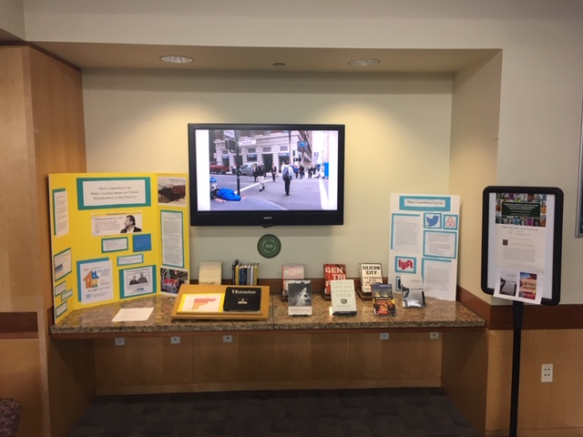 display of student projects on Corporations and Homelessness with books and handouts for more information