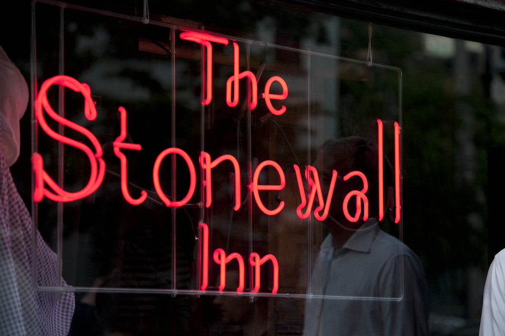 A photo of a neon sign that says The Stonewall Inn.