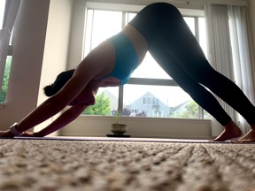 Woman in downward facing dog yoga position